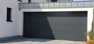 COGNE - porte de garage sectionnelle motorisee